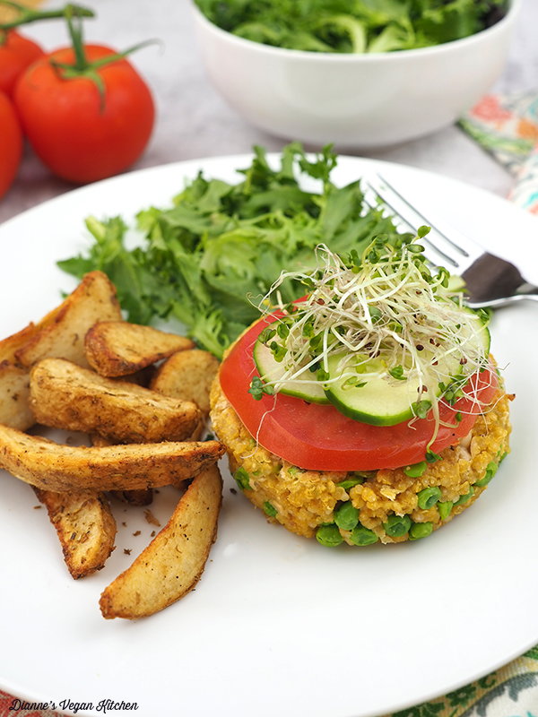 quinoa burger on plate with fries and salad