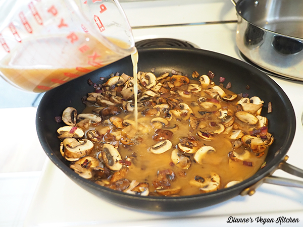 pouring sauce over mushrooms
