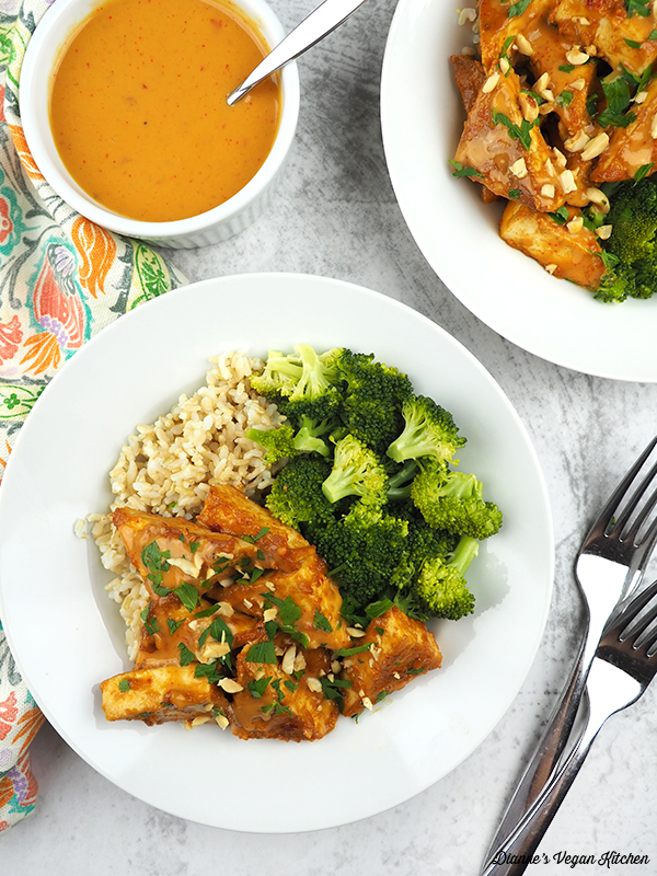 tofu on plates with brown rice and broccoli