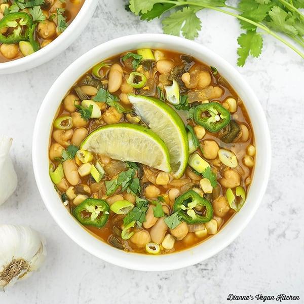 vegan white chili in bowl overhead square