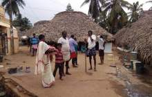 Juggle Mailapally stands with his family in his village. Courtesy: Raksha Kumar