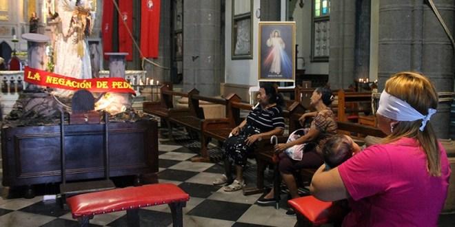 Penitencia y oración en la Calle de La Amargura