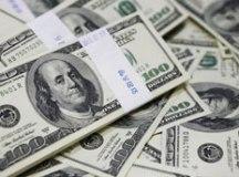 Dólar fecha a R$ 5,036 e desce à menor cotação em um ano