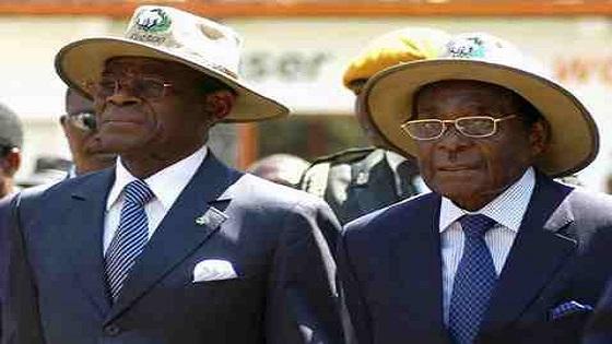 Robert Mugabe junto Teodoro Obiang