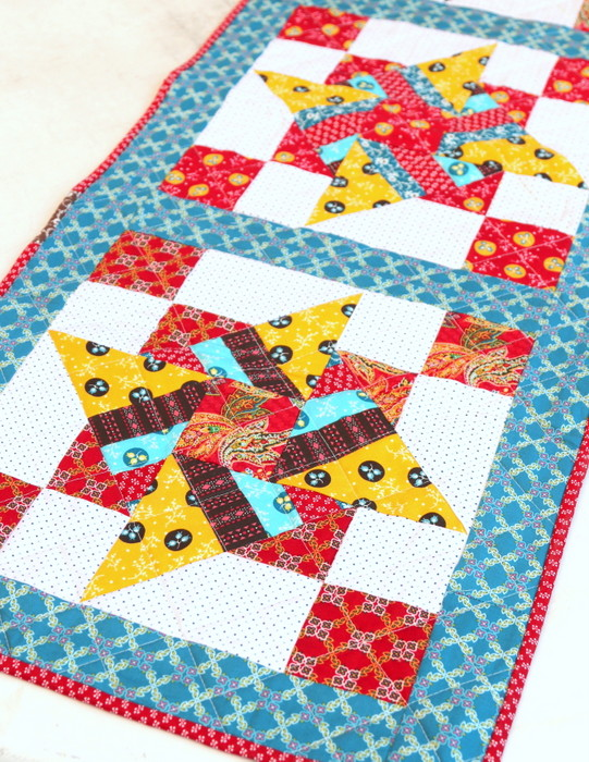 Free Video Class: Strip Piecing Quilt Patterns by popular Utah quilting blog, Diary of a Quilter: image of a spinning stars quilt.