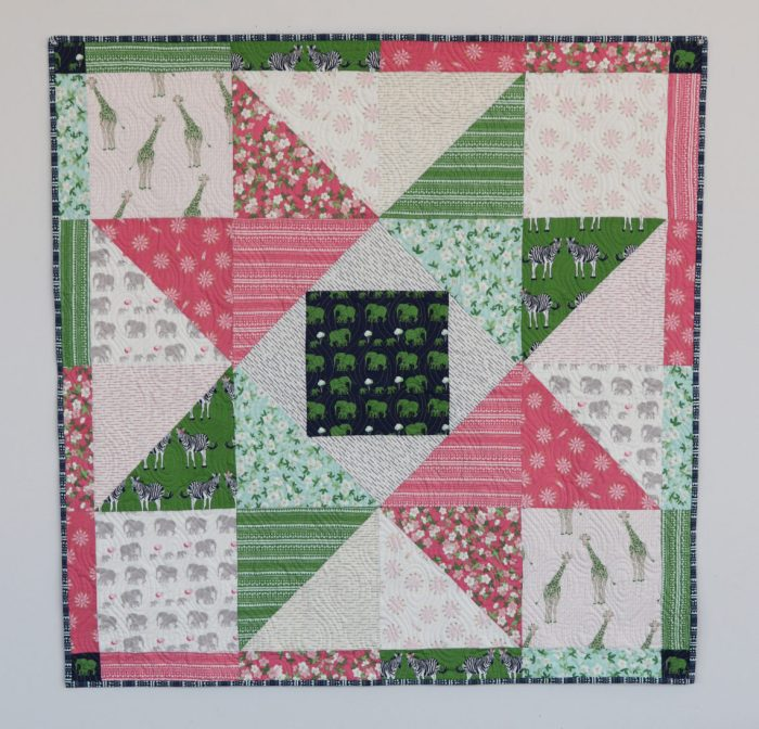 Patchwork Baby Quilt tutorial by Amy Smart, Diary of a Quilter. Fabric = Safari Party by Melissa Mortenson for Riley Blake Designs.