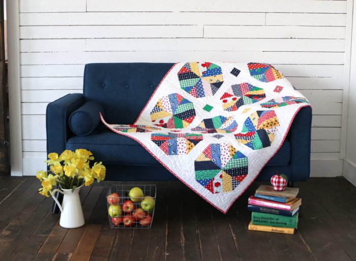 Strip-pieced modern crib quilt pattern by Amy Smart, featuring Sunnyside Ave Fabric collection.