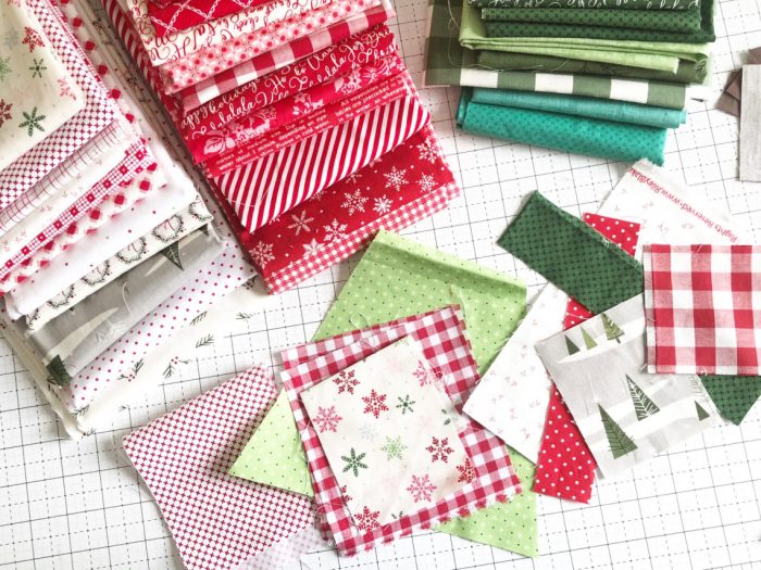 New Patchwork Forest Quilt Pattern: Pine Hollow Version by popular quilting blog, Diary of a Quilter: image of a red, white, and green Christmas fabric blocks.