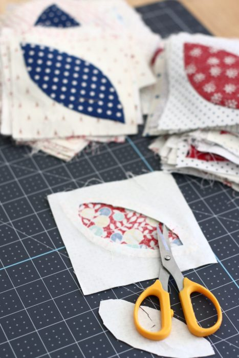 In Search of my Sewing Mojo and Other Tales of Summer by popular sewing blog, Diary of a Quilter: image of sewing scissors, quilting blocks, and a cutting board.