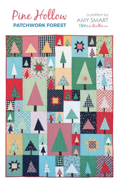 New Patchwork Forest Quilt Pattern: Pine Hollow Version by popular quilting blog, Diary of a Quilter: image of a multi-colored patchwork forest tree quilt by Amy Smart.