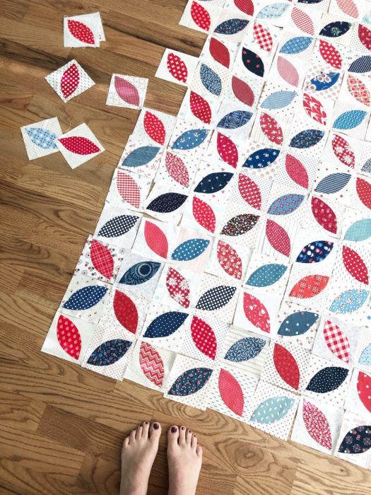 Red and Blue + Low Volume Orange Peel applique blocks | More Orange Peel Applique Blocks + Real Life by popular Utah quilting blog: Diary of a Quilter: image of orange peel applique blocks laid out in a patter on a hard wood floor.