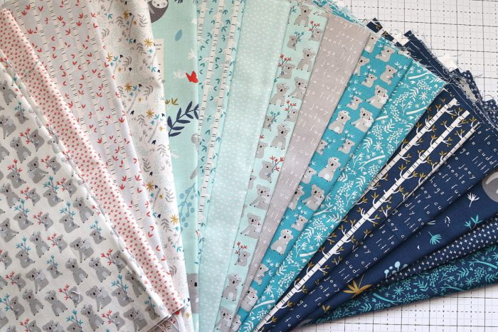 Bricks Baby Quilt Tutorial by popular quilting blog Diary of a Quilter: image of various fat quarters and strips of fabric.