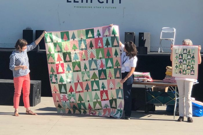 Garden of Quilts 2019 - Thanksgiving Point, Utah by popular quilting blog, Diary of a Quilter: image of women displaying quilts at the Garden of Quilts 2019.