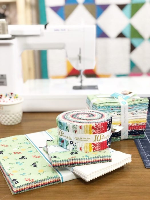 Birthday Bash at Missouri Star Quilt Company by popular quilting blog, Diary of a Quilter: image of fabric jelly rolls at the Missouri Star Quilt Company.