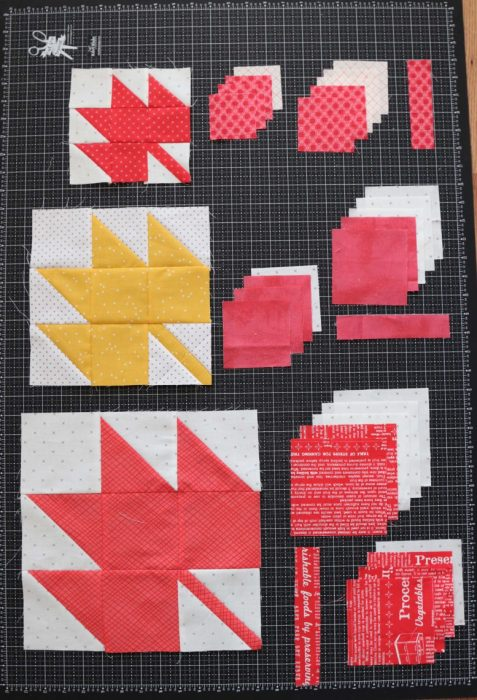 Classic Maple Leaf Quilt Block Tutorial by popular Utah quilting blog, Diary of a Quilter: image of maple leaf quilt blocks on a rotary cutting board.