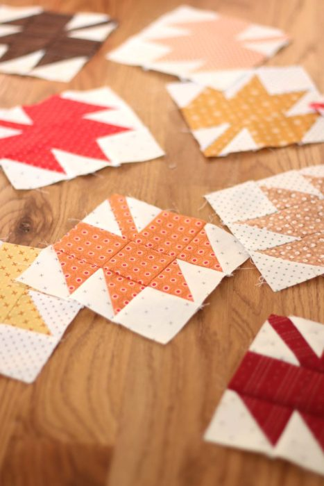 Classic Maple Leaf Quilt Block Tutorial by popular Utah quilting blog, Diary of a Quilter: image of individual maple leaf quilt blocks spread out on a table.