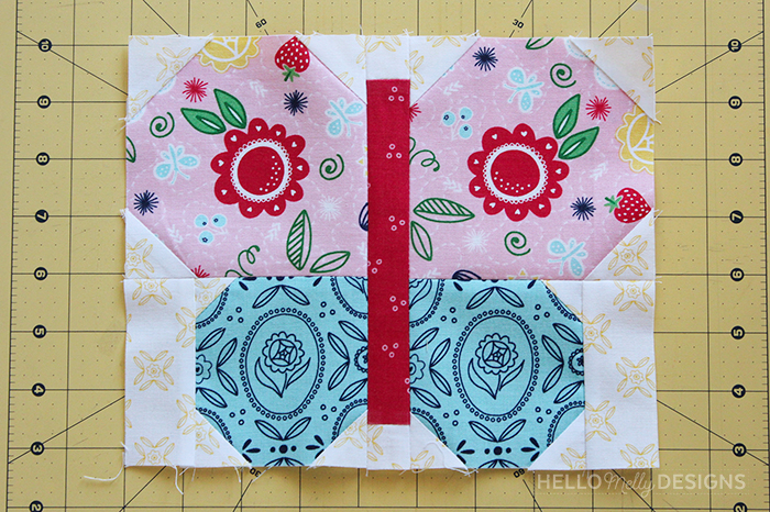 Quilted Butterfly Reading Pillow by Guest Host Melanie Collette by popular quilting blog, Diary of a Quilter: image of a fabric butterfly.