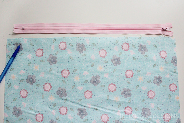 Quilted Butterfly Reading Pillow by Guest Host Melanie Collette by popular quilting blog, Diary of a Quilter: image of blue floral fabric and a pink zipper.