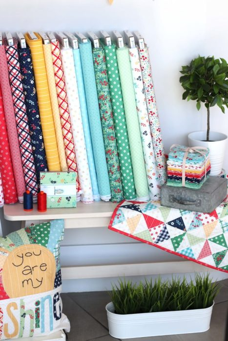 Sugarhouse Park Fabric Collection by Amy Smart by popular Utah quilting blog, Diary of a Quilter: image of Sugarhouse Park fabric bolts, fat quarters, and bundles.