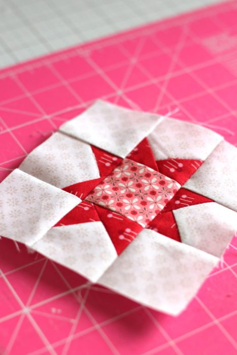 Pine Hollow Quilt Along Week 5 by popular quilting blog, Diary of a Quilter: image of a red and white quilting block.