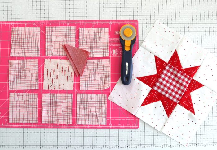 How to make a Wonky Star Quilt Block   Pine Hollow Patchwork Forest Quilt Along Week 4 by popular Utah quilting blog, Diary of a Quilter: image of a wonky star quilt block, cutting board and rotary cutter.