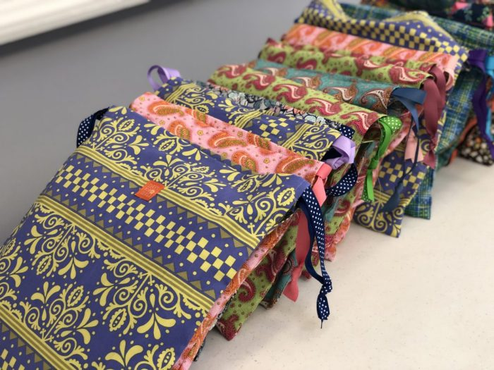 Days For Girls by popular quilting blog, Diary of a Quilter: image of various handmade menstrual cycle kits.