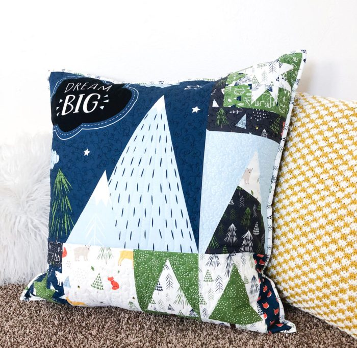 Snow-capped Mountain Quilt Block Tutorial by popular Utah quilting blog, Diary of a Quilter: image of a pillow with mountain quilt blocks.
