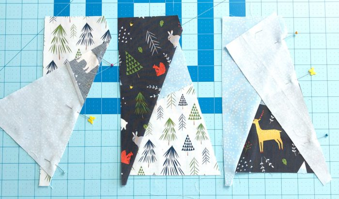 Snow-capped Mountain Quilt Block Tutorial by popular Utah quilting blog, Diary of a Quilter: image of fabric cut in the shape of mountains.