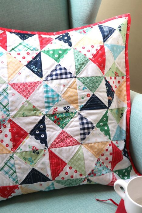 Hourglass Quilt Block Shortcut Video Tutorial by popular Utah quilting blog, Diary of a Quilter: image of a pillow cover with the hourglass quilt block.