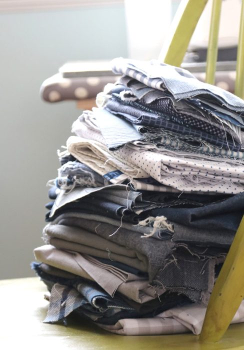 Stack of denim, gingham, and other woven blue fabrics