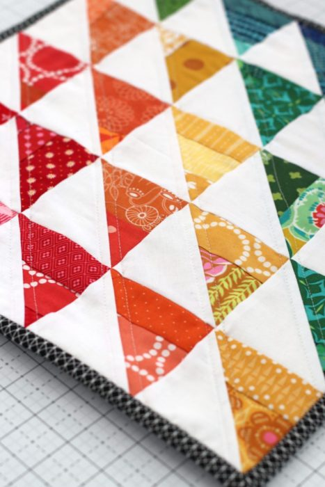 Half Square triangle scrap mini quilt by Amy Smart