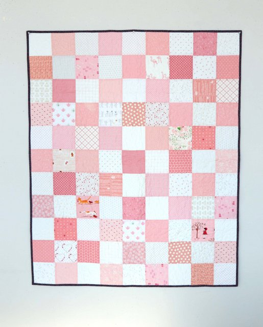 Pink and White Checkerboard patchwork quilt by Amy Smart