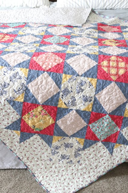 Queen Size quilt variation of Palace Court - featuring Notting Hill fabric