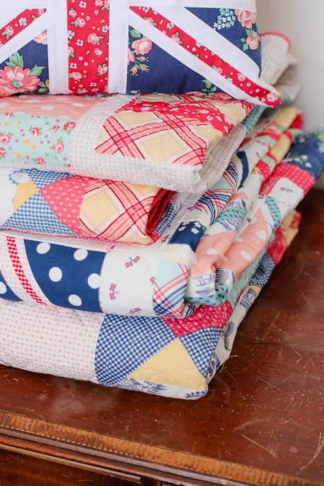 Stack of Notting Hill quilts by Amy Smart