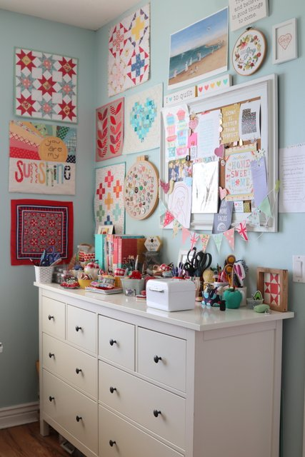 Mini Quilts hanging in a sewing room