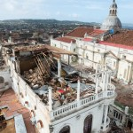 The roof and walls were ripped off the top floor of this six-story building opposite the Cathedral.