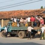 and overloaded Trucks used as primary means of public transportation...
