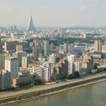Arial view of Pyongyang looking at the Ryugyong Hotel with the Taedong River, dividing the city, in the foreground