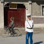 Traffic Policeman in front of Kaesong Famous Noodle house with a sign over the door commemorating when Kim Il Song visited in 1968. Kaesong was the only North Korean city not destroyed by American bombing during the Korean War.