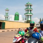 Motorcyclists in Front of Mosque