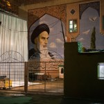 Outside the Ayatollah Khomeini Mausoleum in Tehran.  The mosque, mausoleum, and complex span over 5,000 acres and will cost 2 billion dollars to complete. Khomeini's image evokes fear in many Westerners while most Iranians revere him as the founder of the Revolution.