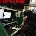 Many of the traders on floor of the Tehran Stock Exchange are women.