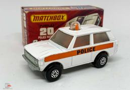 Matchbox Superfast Police Patrol, orange light and interior. Rolamatic box Unpainted base. Model is in good to excellent condition, box is excellent plus.