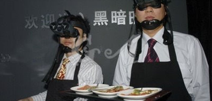 These were the waiters in the restaurant Inside The Whale opened in Beijing in 2007 but it has closed. The waiters wear glasses to see in the dark.