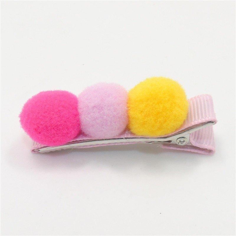 Haarclips omPom mit 3 verschieden färbigen Filzkugeln. Die Macherei
