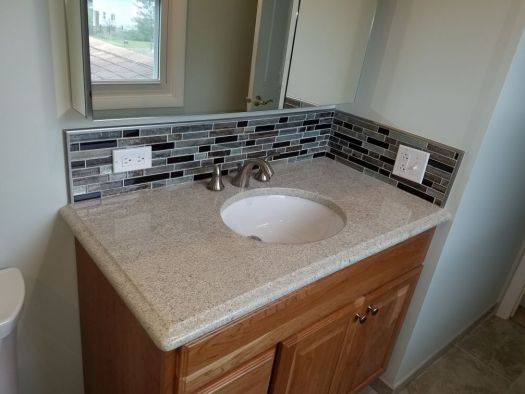 Bathroom Remodeling Sink with Tile Backsplash and Mirror