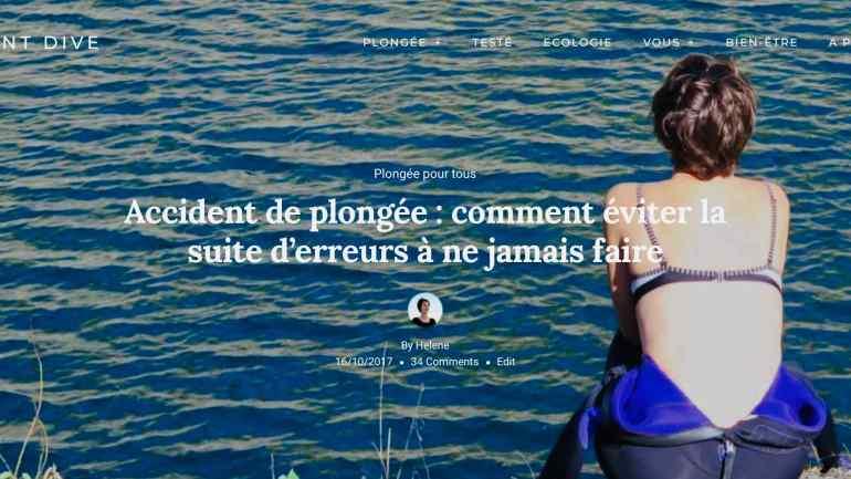 Une femme en combinaison de plongée est tournée vers l'eau