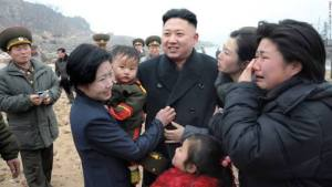 Kim Jong-Un with family of a soldier