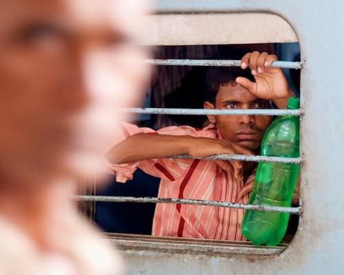 2. Waiting on a Train - Old Delhi, India - Copyright 2011 Ralph Velasco