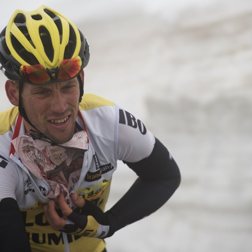 Maarten Tjallingii (NLD/LottoNL-Jumbo) getting a 'gazetta' underneath his jersey up the snow-covered Colle dell'Agnello (2744m) to protect him against the cold on the way down. stage 19: Pinerolo(IT) - Risoul(FR) 162km 99th Giro d'Italia 2016